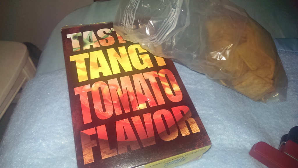 Crackers in box labeled 'Tasty Tangy Tomato Flavor'