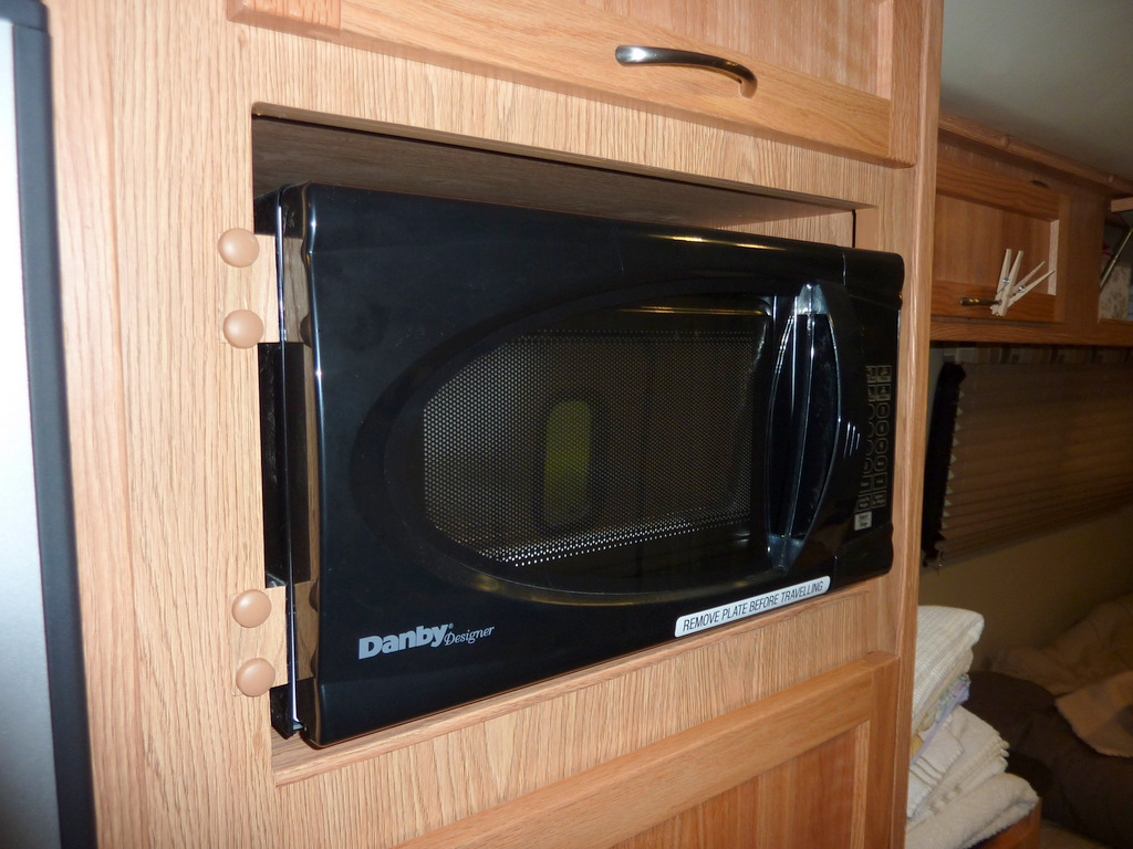 Microwave oven installed in Toto's cabinetry.