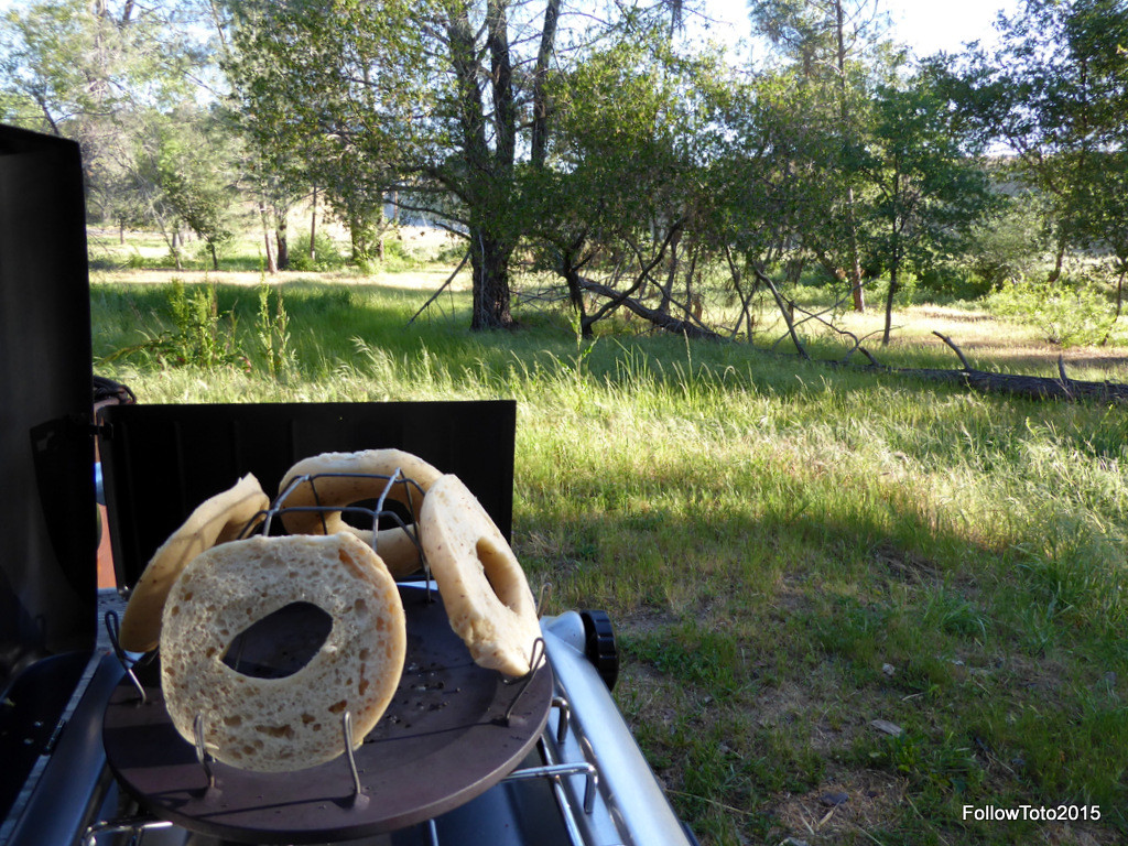 Bagels toasting on the outdoor camp stove.