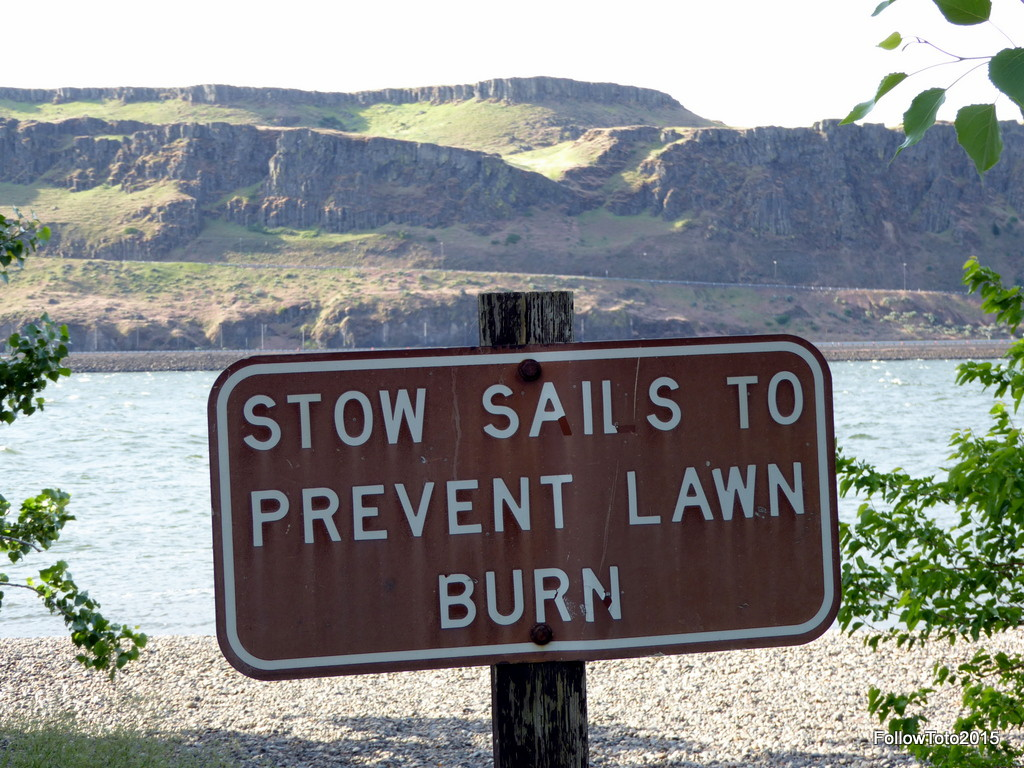 "Beach sign: ""Stow Sails to Prevent Lawn Burn"""