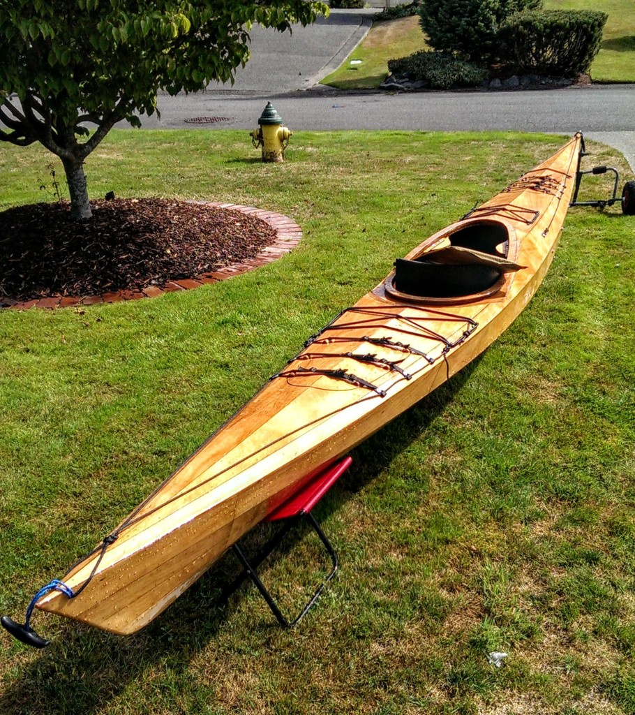 Kayak on lawn, looking clean.