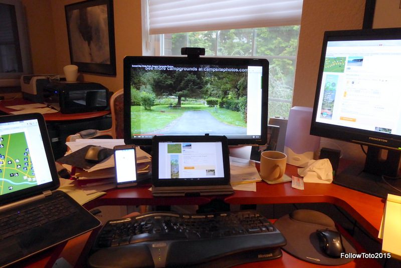 Laptop, smartphone, tablet, two desktop monitors, all on campsite reservation sites.