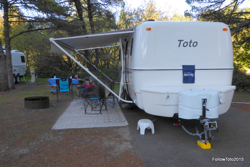 Toto the trailer, plus all the usual campsite stuff: chairs, mat, tablecloth, awning, Seahawks flag.