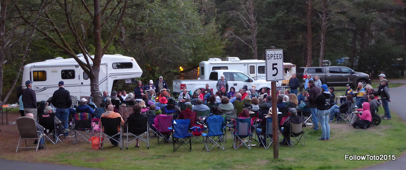 100 fiberglass trailer enthusiasts, mostly in their folding camp chairs, enjoying a pot luck dinner.