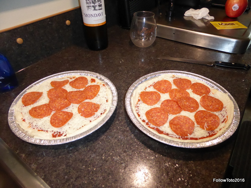 "The gourmet pizza pies, ready for the dutch oven. Apparently Sooz put an ingredient called ""Mondavi"" in the pizza."